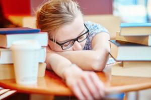girl sleeping on a desk