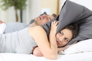 woman mad at man for snoring